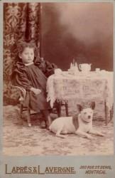 Antique photo of a girl, a dog, a tea party