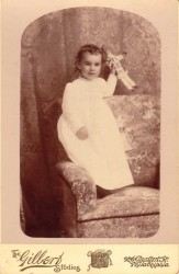 Antique photo of a girl and doll
