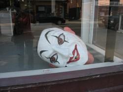 White Monkey Head in Window